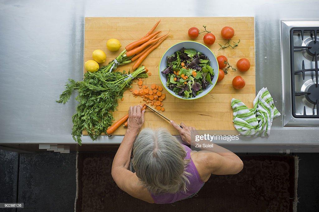overhead view, woman making salad : Stock Photo