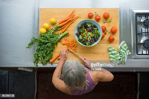 overhead view, woman making salad