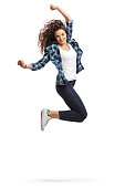 Overjoyed teen girl jumping and gesturing happiness isolated on white background