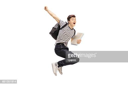 Estudiante adolescente alegría saltando y gesticular felicidad : Foto de stock