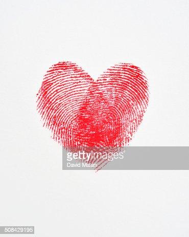 Overlapping fingerprints forming a heart shape