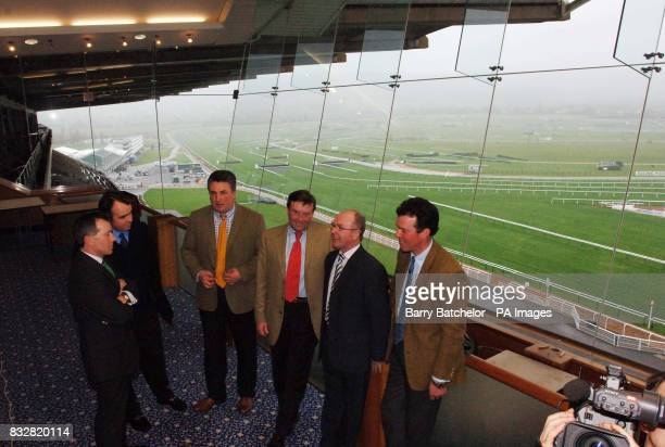 Overlooking Cheltenham Racecourse are Cheltenham Racecourse Director of Racing and Clerk of the Course Simon Claisse with trainers Alan King Paul...