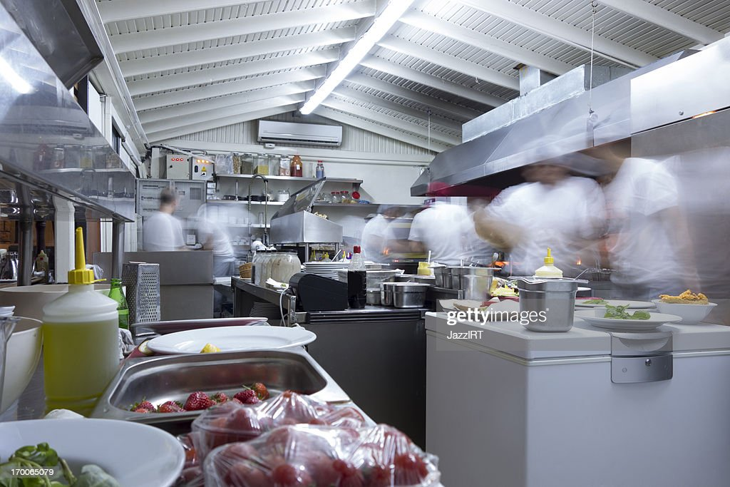 Busy Restaurant Kitchen overly busy restaurant kitchen stock photo | getty images