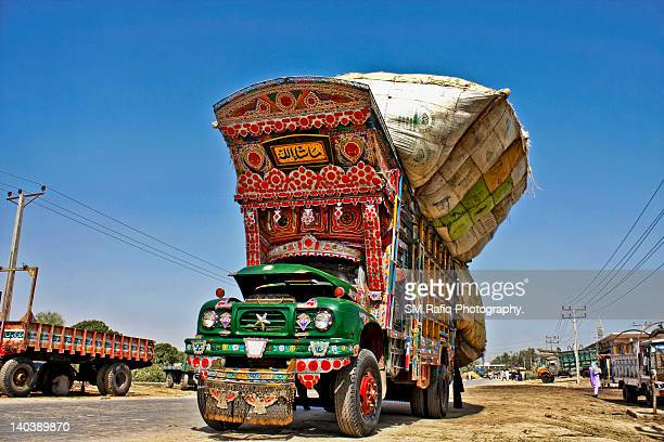 Overly loaded truck  on road