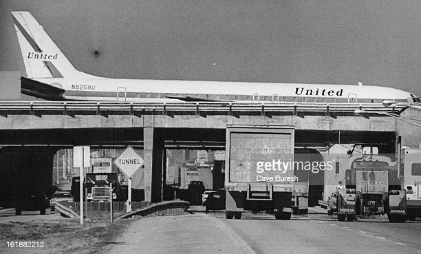MAR 22 1974 Overpass Tested To Determine Strength A United Air Lines plane is parked above Interstate 70 on northsouth runway at Stapleton...