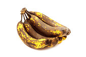 Photograph of a bunch of overripe bananas set against a white background.  Perfect for making banana bread!