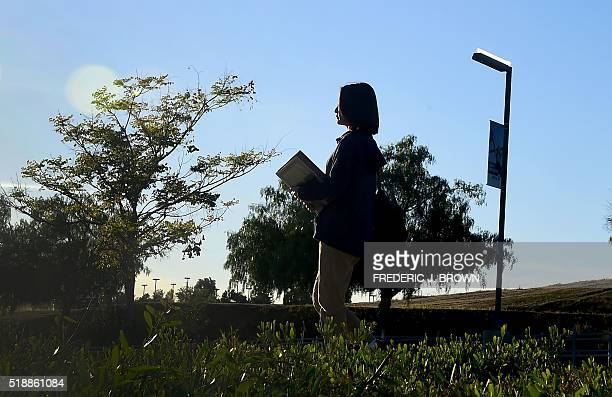 Overseas Chinese student Helen Zhou from Chengdu heads to Choir practice on campus at Linfield Christian School in Temecula California on March 23...