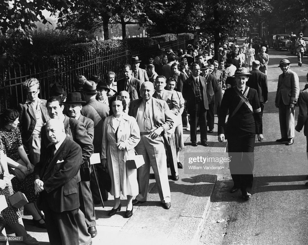 Overseas citizens queue to register outside Golders Green alien office at the start of World War II 5th September 1939 There were so many applicants...