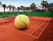 Oversized ball on an outdoor tennis court