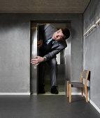 Oversized businessman in an elevator