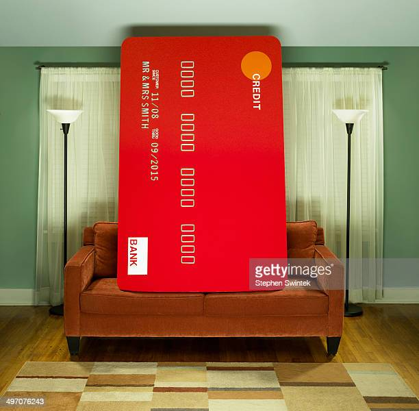 Oversized credit card on couch