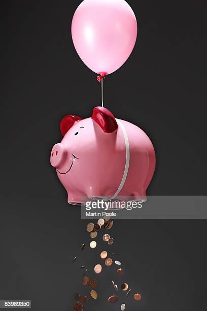 oversized piggy bank losing money