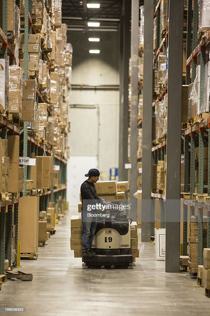 Overstock.com Inc. employee Duc Tran picks out large products for orders at the company's distribution center in Salt Lake City, Utah, U.S., on Tuesday, Dec. 18, 2012. Online sales may grow to a record $43.4 billion in the last two months of the year, a 17 percent increase from last year, according to ComScore Inc. Photographer: Ken James/Bloomberg via Getty Images