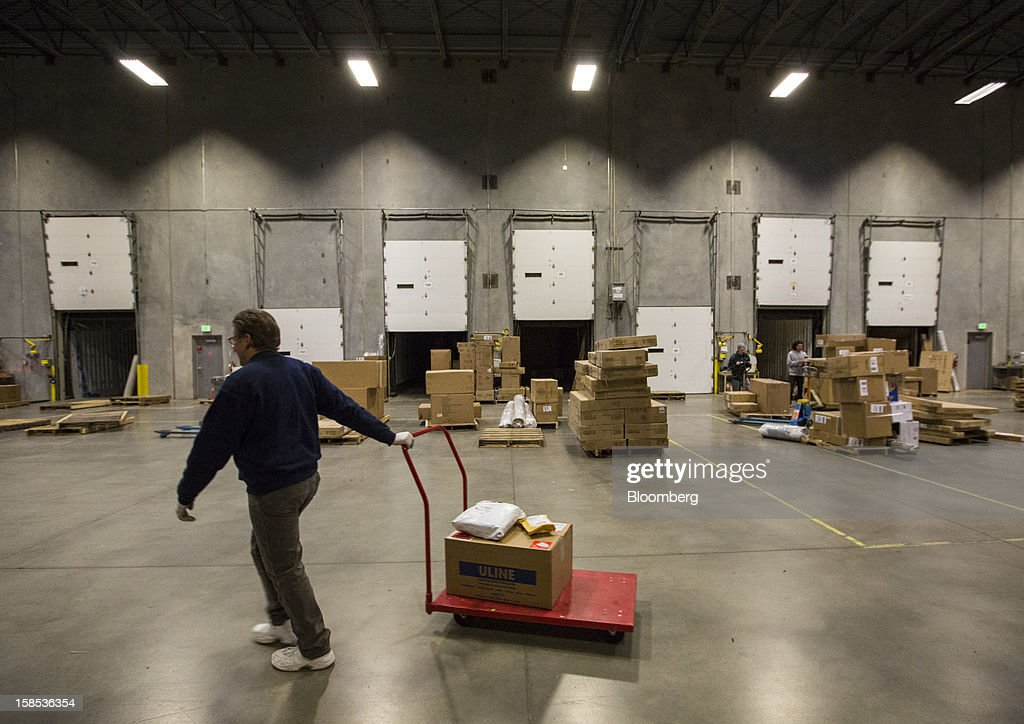Overstock.com Inc. employee Jeff Kemp picks out large products for orders at the company's distribution center in Salt Lake City, Utah, U.S., on Tuesday, Dec. 18, 2012. Online sales may grow to a record $43.4 billion in the last two months of the year, a 17 percent increase from last year, according to ComScore Inc. Photographer: Ken James/Bloomberg via Getty Images