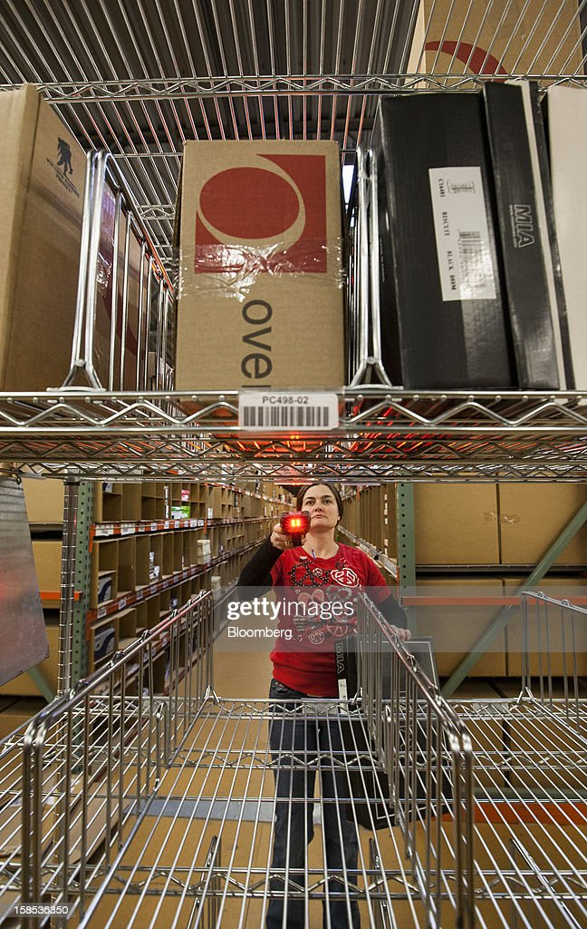 Overstock.com Inc. employee Mabel Mitchell picks out products for orders during one of the busiest days prior to Christmas at the company's distribution center in Salt Lake City, Utah, U.S., on Tuesday, Dec. 18, 2012. Online sales may grow to a record $43.4 billion in the last two months of the year, a 17 percent increase from last year, according to ComScore Inc. Photographer: Ken James/Bloomberg via Getty Images