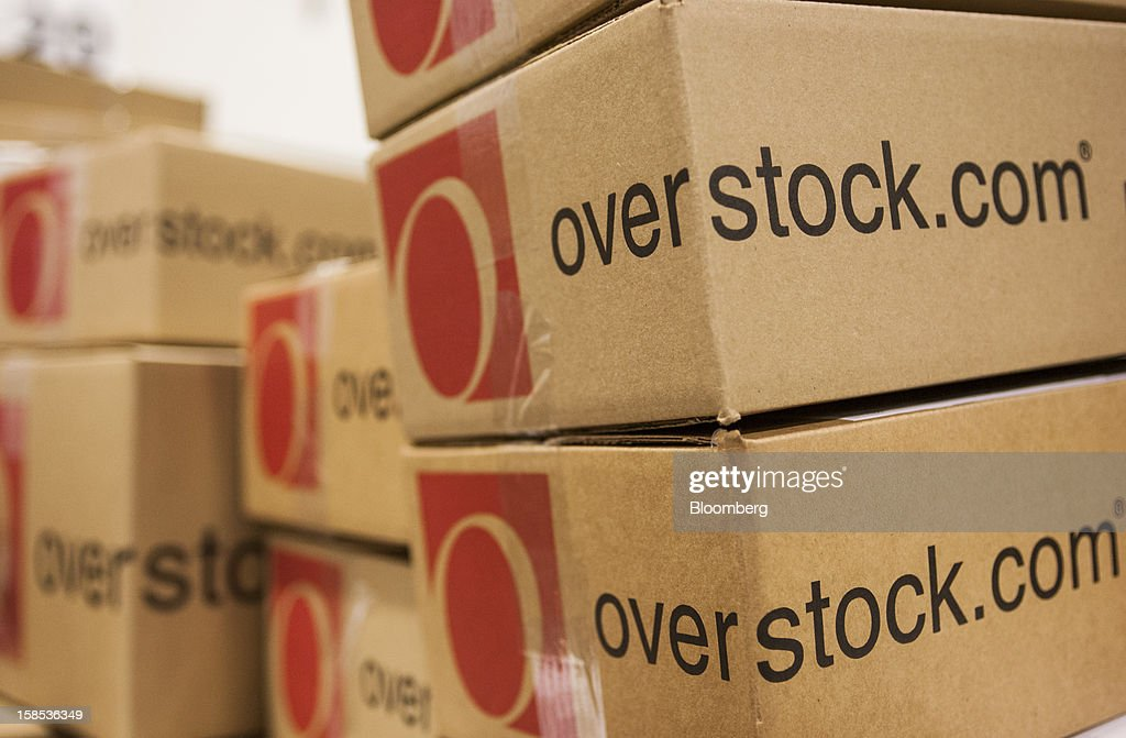 Overstock.com Inc. orders sit stacked in the shipping area at the company's distribution center in Salt Lake City, Utah, U.S., on Tuesday, Dec. 18, 2012. Online sales may grow to a record $43.4 billion in the last two months of the year, a 17 percent increase from last year, according to ComScore Inc. Photographer: Ken James/Bloomberg via Getty Images