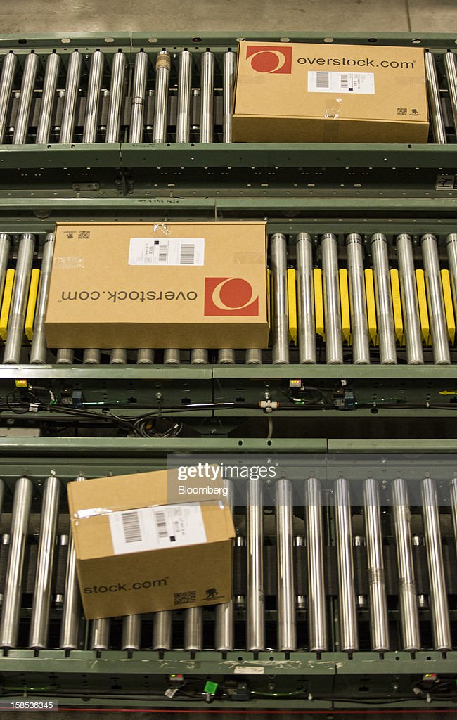 Overstock.com Inc. orders travel down a conveyor belt to the shipping area at the company's distribution center in Salt Lake City, Utah, U.S., on Tuesday, Dec. 18, 2012. Online sales may grow to a record $43.4 billion in the last two months of the year, a 17 percent increase from last year, according to ComScore Inc. Photographer: Ken James/Bloomberg via Getty Images