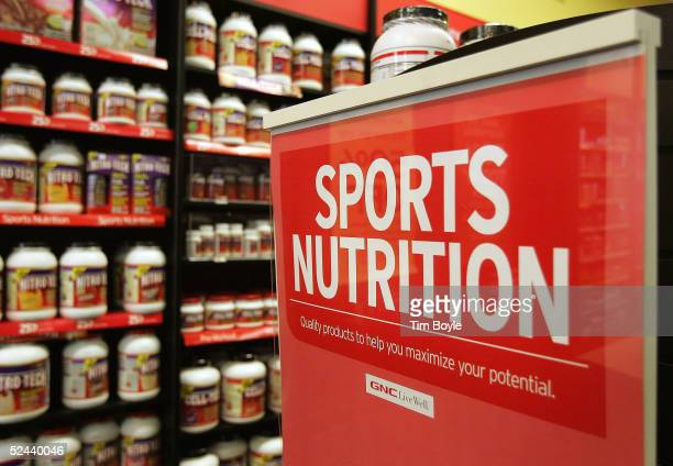 Overthecounter bodybuilding supplements sit on a shelf in a General Nutrition Centers store March 17 2005 in Des Plaines Illinois Stores such as GNC...