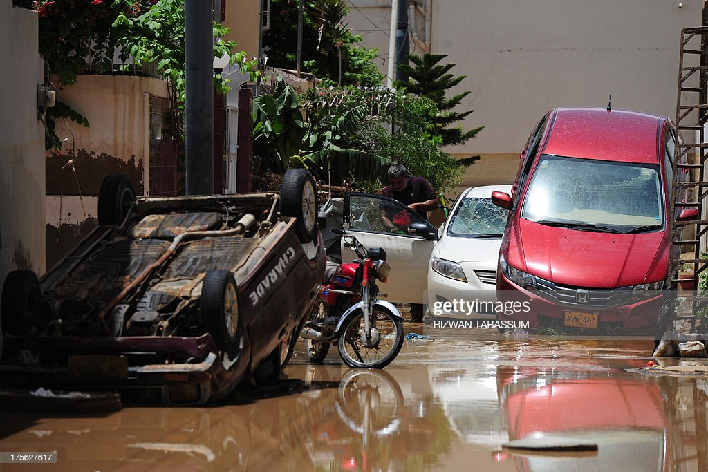 Overturned and damaged vehicles are pictured in the aftermath of floods at a residential area of Karachi on August 5, 2013. Pakistani disaster relief officials issued fresh flood warnings after the death toll from heavy monsoon rains rose to 45 and waters paralysed parts of the largest city Karachi. Flash floods caused by monsoon downpours have inundated some main roads in the sprawling port city and swept away homes in the northwestern province of Khyber Pakhtunkhwa.