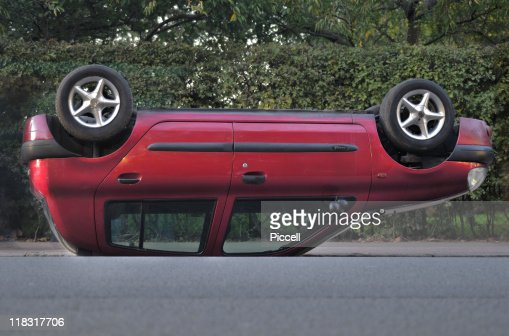 Overturned car in street : Stock Photo