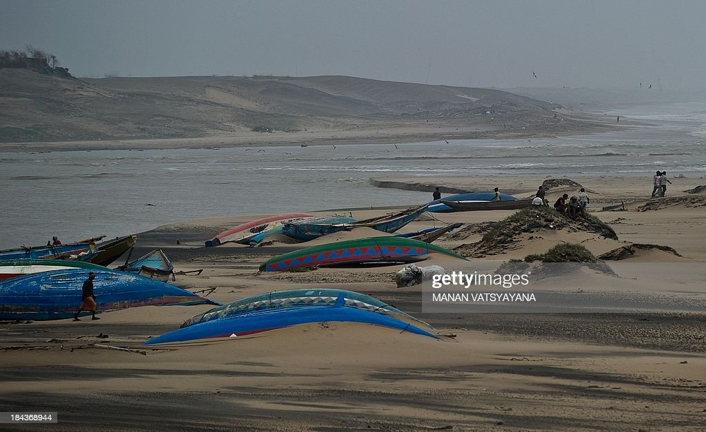 Overturned fishing boats are seen at the Gopalpur beach on October 13, 2013. Cyclone Phailin left a trail of destruction along India's east coast and up to seven people dead after the biggest evacuation in the country's history helped minimise casualties.