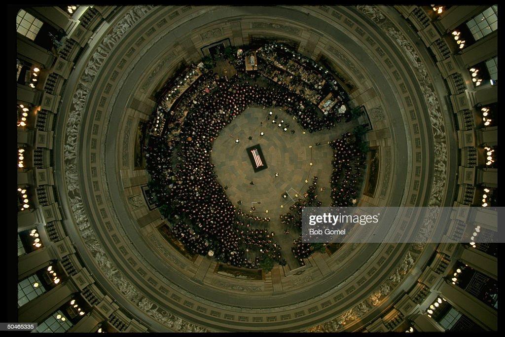 Overveiw of Capitol bldg. rotunda w. Pres. Eisenhower lying in state.