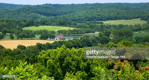 Overview of a scenic farm in early summer as seen from the Natchez Trace Parkway near Fall Hollows : Stock Photo