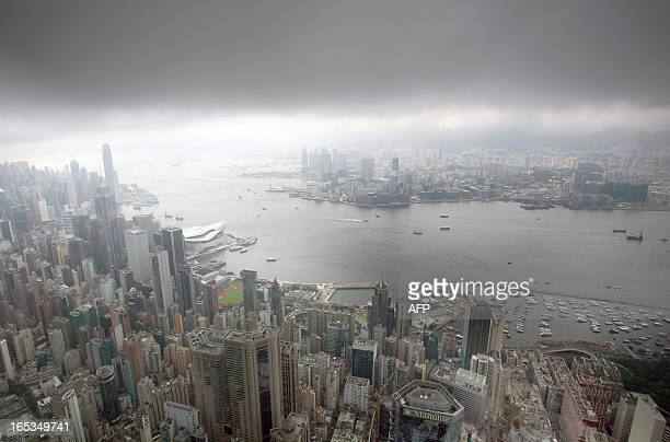 Overview of Hong Kong skyline and its harbour during a downpour and thunderstorms 07 June 2007 China will maintain the capitalist economic system in...