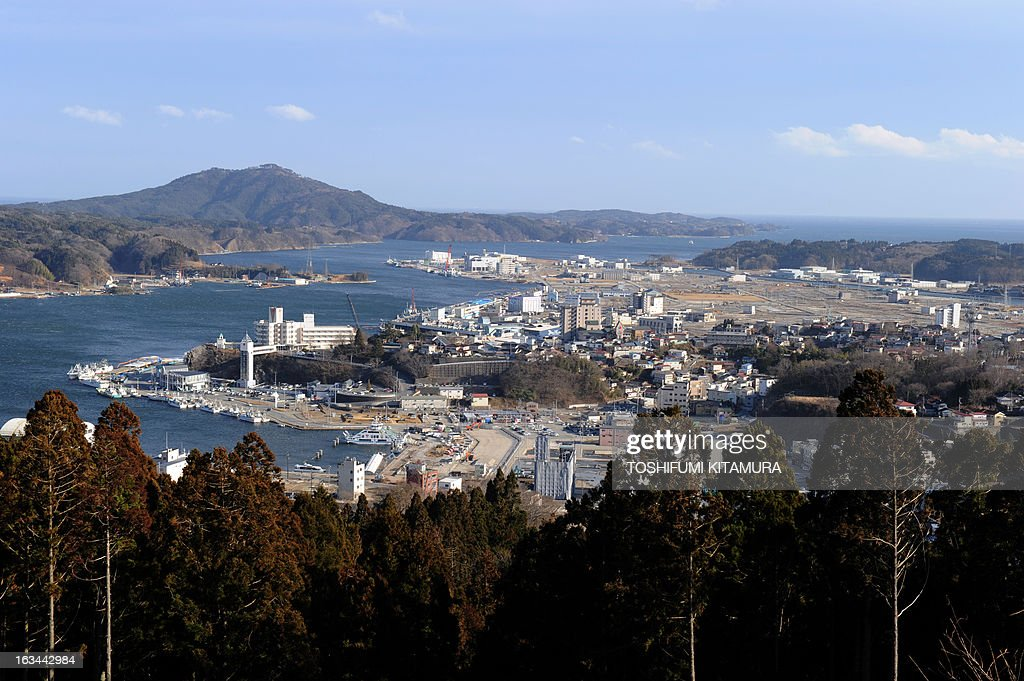 Overview of Kesennuma city, Kesennuma Bay and Oshima island in Miyagi prefecture on March 10, 2013. sMarch 11, 2013 marks the second anniversary of the 9.0 magnitude earthquake that sent a huge wall of water into the coast of the Tohoku region, splintering whole communities, ruining swathes of prime farmland and killing nearly 19,000 people.
