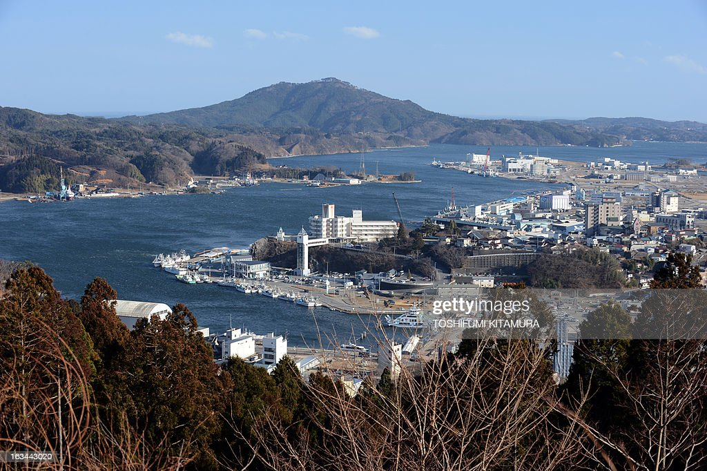 Overview of Kesennuma city, Kesennuma Bay and Oshima island in Miyagi prefecture on March 10, 2013. March 11, 2013 marks the second anniversary of the 9.0 magnitude earthquake that sent a huge wall of water into the coast of the Tohoku region, splintering whole communities, ruining swathes of prime farmland and killing nearly 19,000 people.