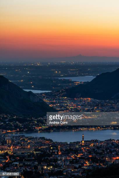 Overview of Lecco at twilight. Monviso in the background. Morterone, Lecco, Lombardy