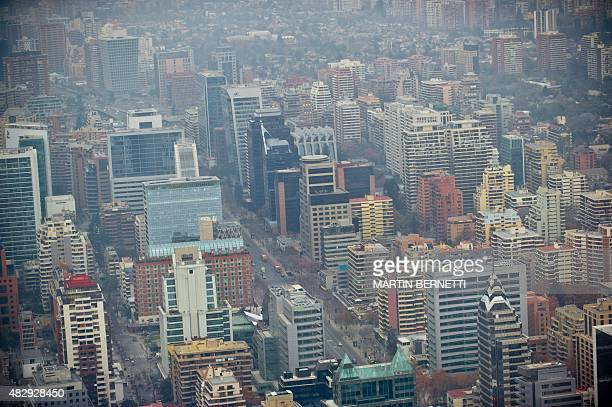 Overview of Santiago showing a layer of smog caused by emissions from local industries and the growing number of cars on August 12015 AFP...