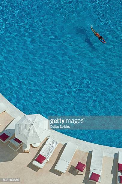 Overview of woman swimming in pool, Cancun, Mexico