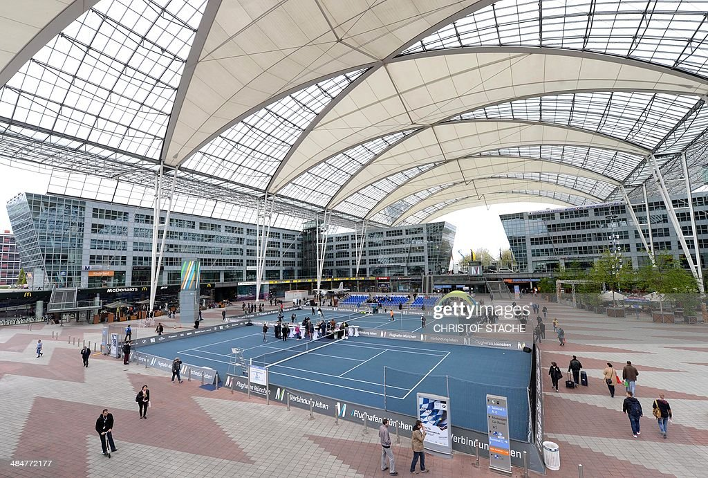 Overview picture of tennis courts which are built between two terminals of the Franz-Josef-Strauss-airport in Munich, southern Germany, during a show match on April 14, 2014. The show match is a promotional event for the Munich held BMW open tennis tournament. The tournament will be held from April 26 until May 4, 2014.