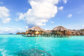 Overwater bungalows in the lagoon of Bora Bora