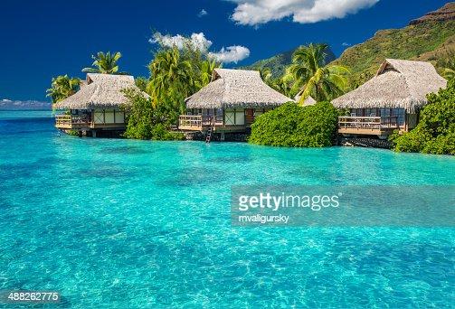 Overwater villas in lagoon of Moorea Island : Stock Photo
