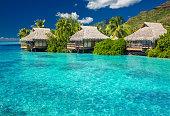 Overwater villas in tropical lagoon of Moorea Island