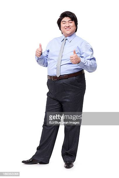 Overweight businessman doing thumbs up