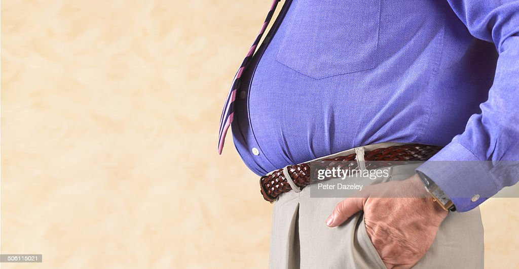 Overweight businessman with copy space