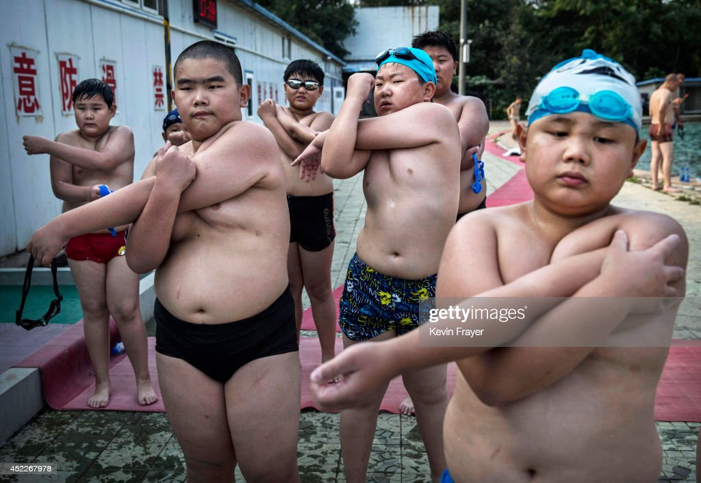 Overweight Chinese students stretch after swimming during training at a camp held for overweight children on July 15, 2014 in Beijing, China. Obesity is a growing problem amongst the burgeoning middle-class in China, and recent studies show that the country is now the second fattest in the world behind the United States. Many parents send their children to special summer camps in an effort to get them into shape and prepare them for the hectic challenges of life in one of the world's largest economies.