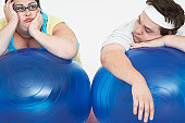 Overweight Couple Resting on Exercise Balls