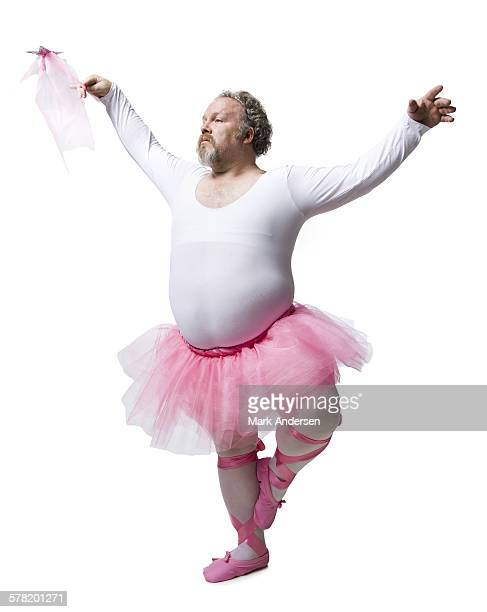 Overweight man in ballerina tutu smiling
