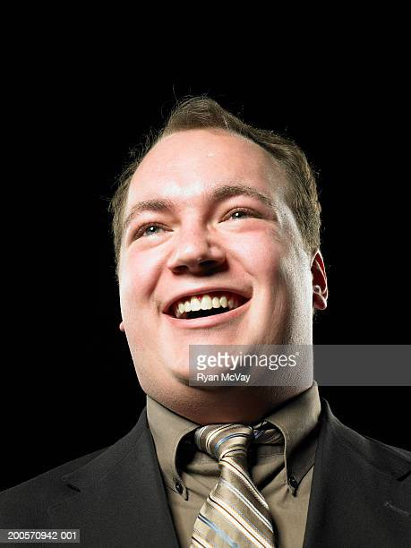 Overweight man laughing, head and shoulders