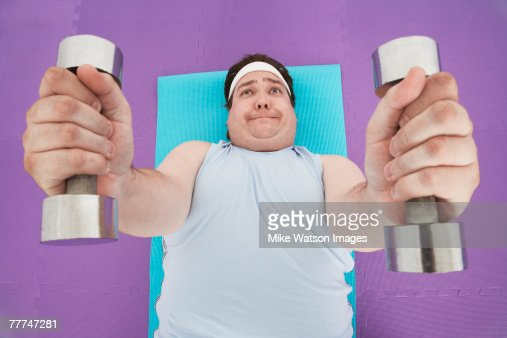 Overweight Man Lifting Weights : Stock Photo