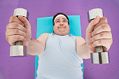 Overweight Man Lifting Weights