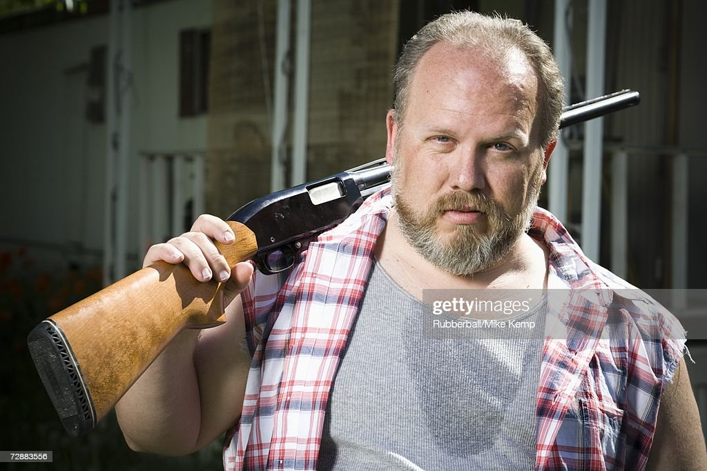 Overweight Man With A Shotgun Stock Photo | Getty Images