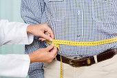 Medical examination: doctor measures overweight