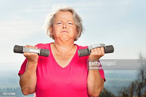 overweight senior woman exercising with effort