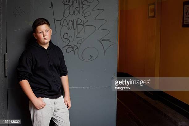 overweight teenage boy in front of school