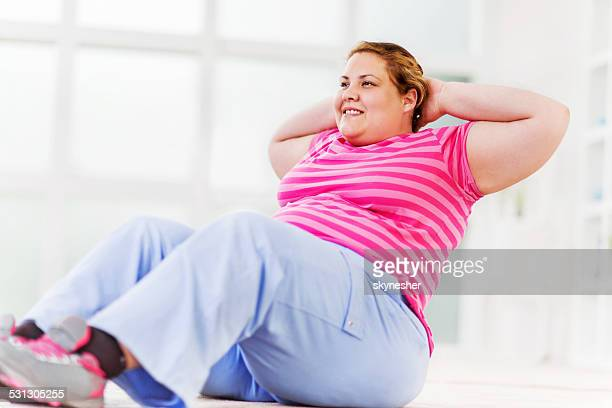 Overweight woman exercising.